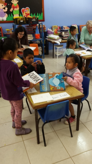 Showing off their books to each other and sharing.