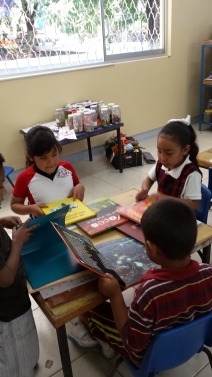 Students looking at their new books.