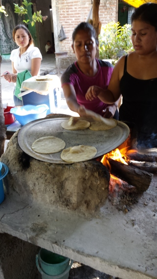 Cooking the tortillas. Everything is done by hand, including turning and picking up the cooked tortillas. It is also amazing how rapidly it is done.