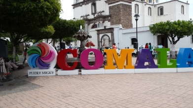 Comala sign in front of fountain