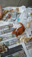 Cooked Maryland crab, seasoned with Old Bay seasoning, wooden mallet at the ready...